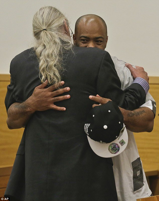 Here Jabbar Washington Washington hugs his criminal defence lawyer, shortly after being exonerated.