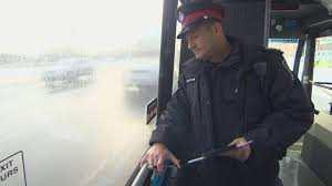 Sgt. Aaron Sidenberg of York Regional Police rides the bus to spot texting drivers.