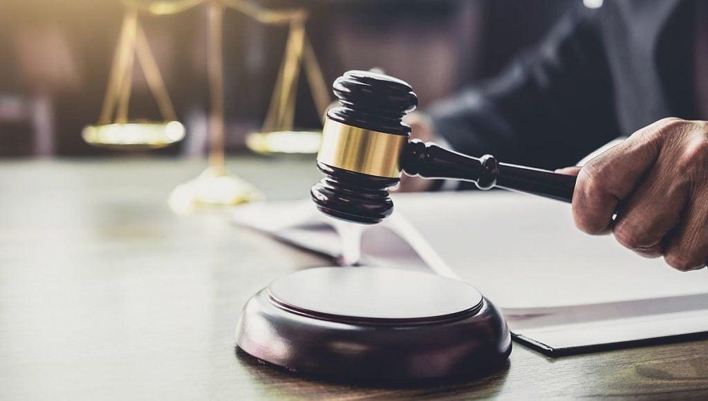 court judge using gavel